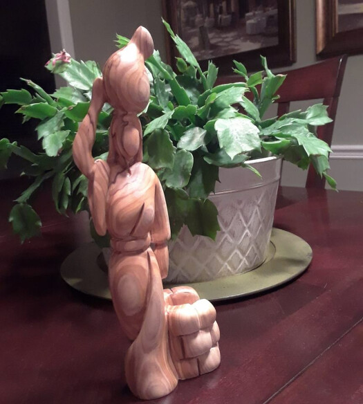 olive wood woman at the well statue
